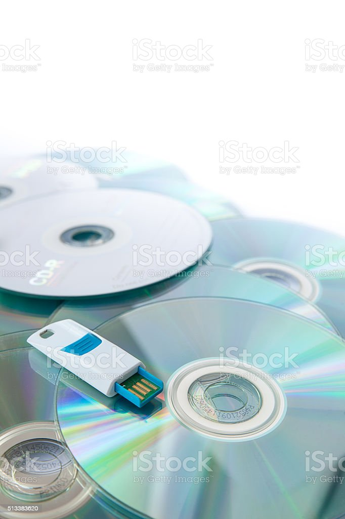 USB flash drives on stacked CDs isolate on white background. stock photo