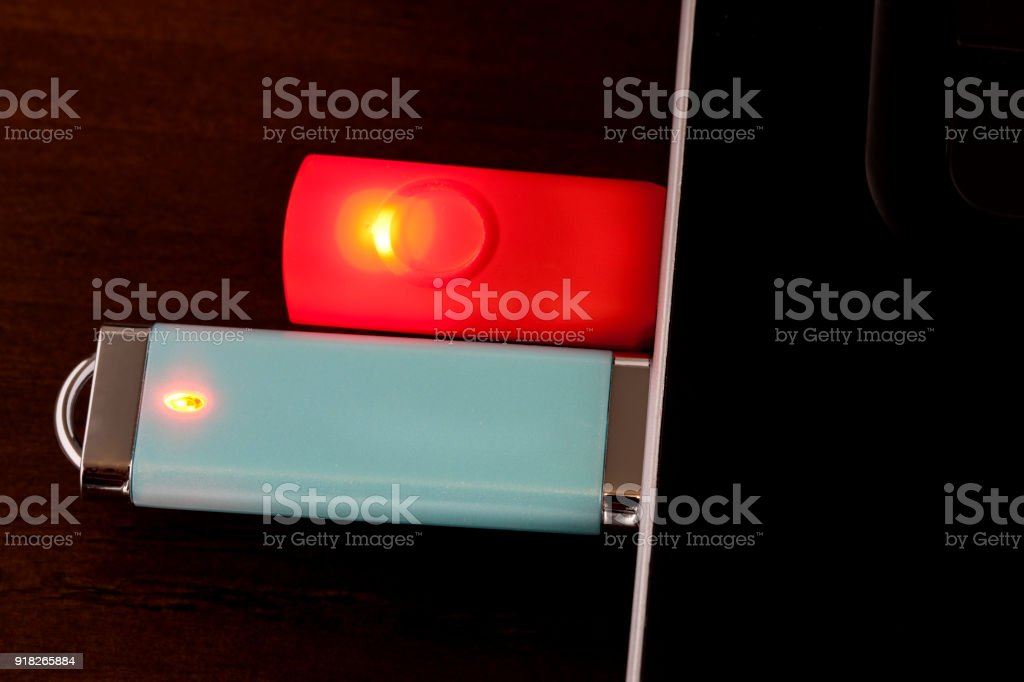 Flash drives or USB Drives plugged in to laptop, looking down stock photo