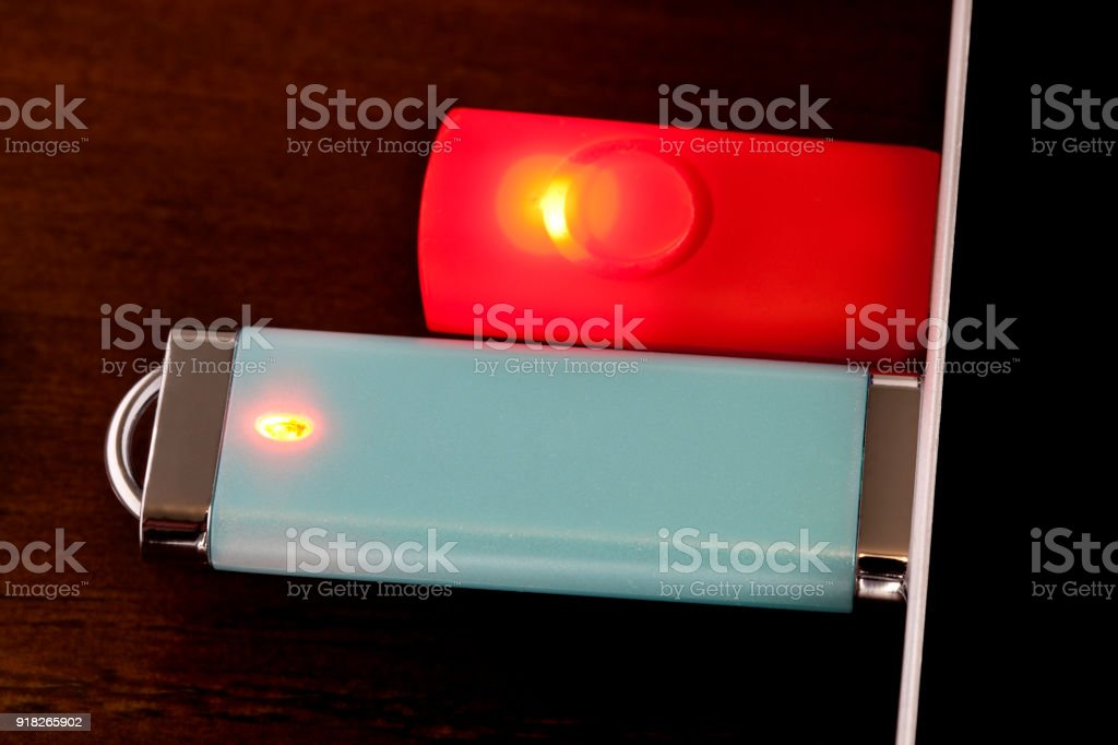 Flash drives or USB Drives plugged in to laptop, macro stock photo