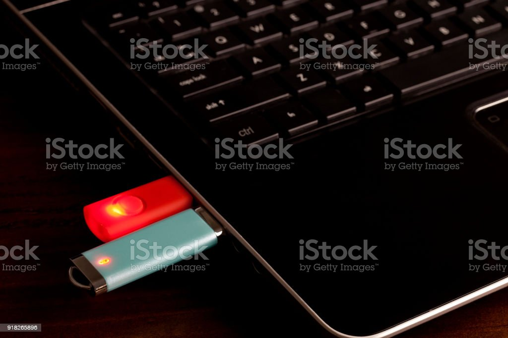 Flash drives or USB Drives plugged in to laptop stock photo