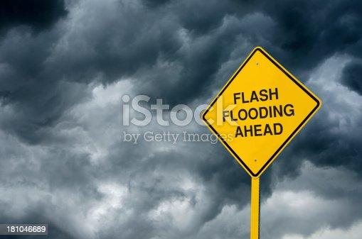 istock Flash Flooding Ahead Road Sign 181046689