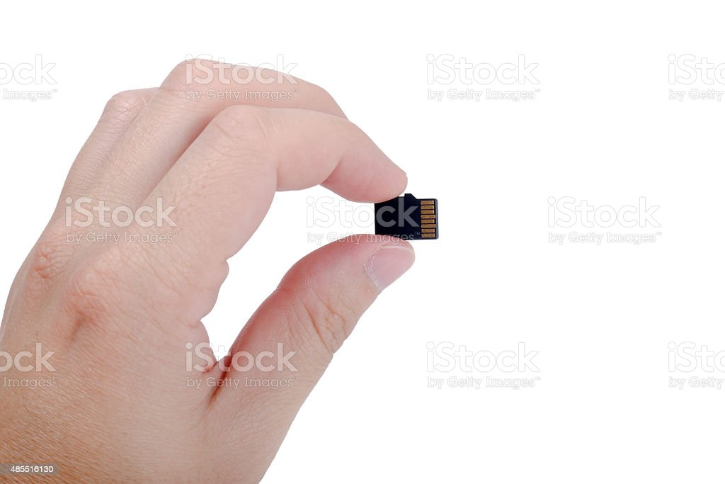 Flash media SD card in hand isolated on white background stock photo