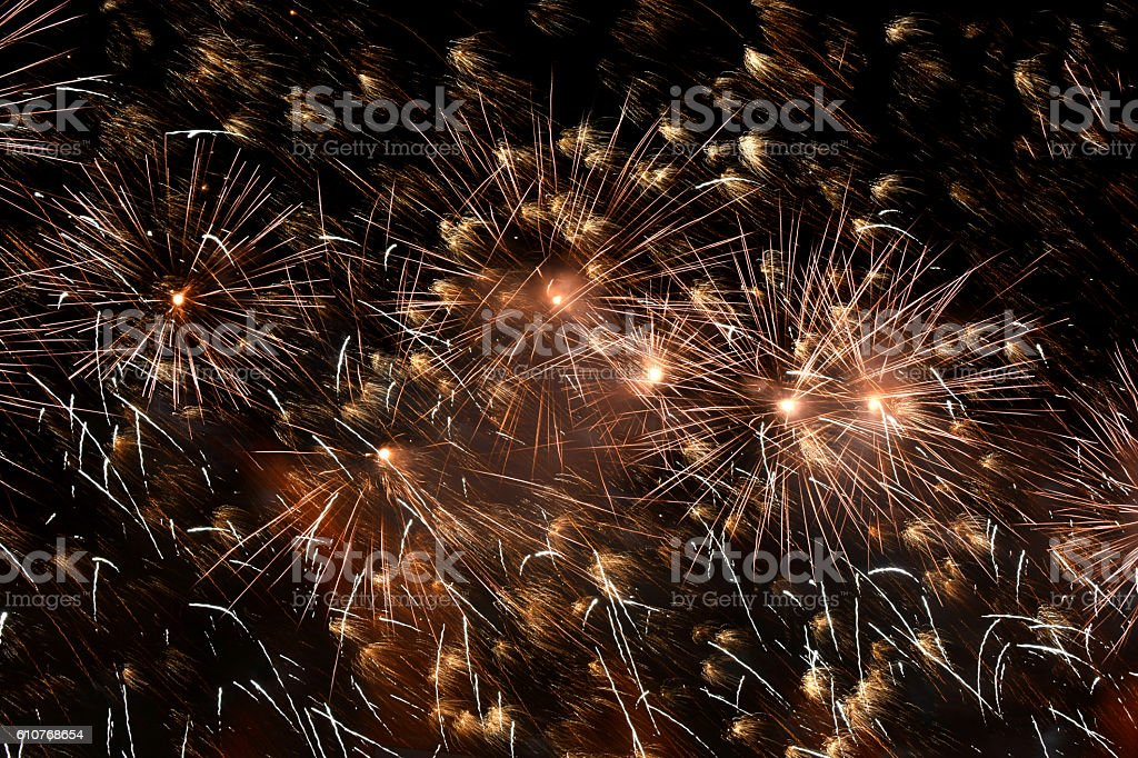 flash of fireworks in the night sky stock photo
