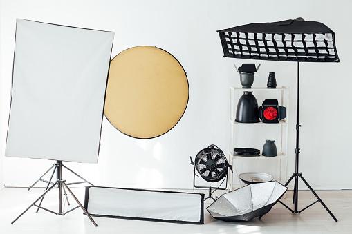 istock Flash photo studio accessories photographer equipment interior 1218224020