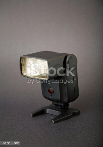 Old flash isolated on dark background