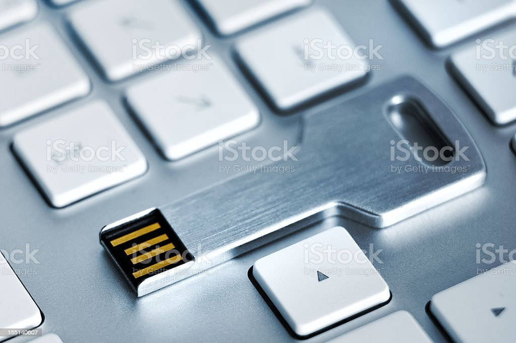 USB flash storage metal key on Keyboard stock photo