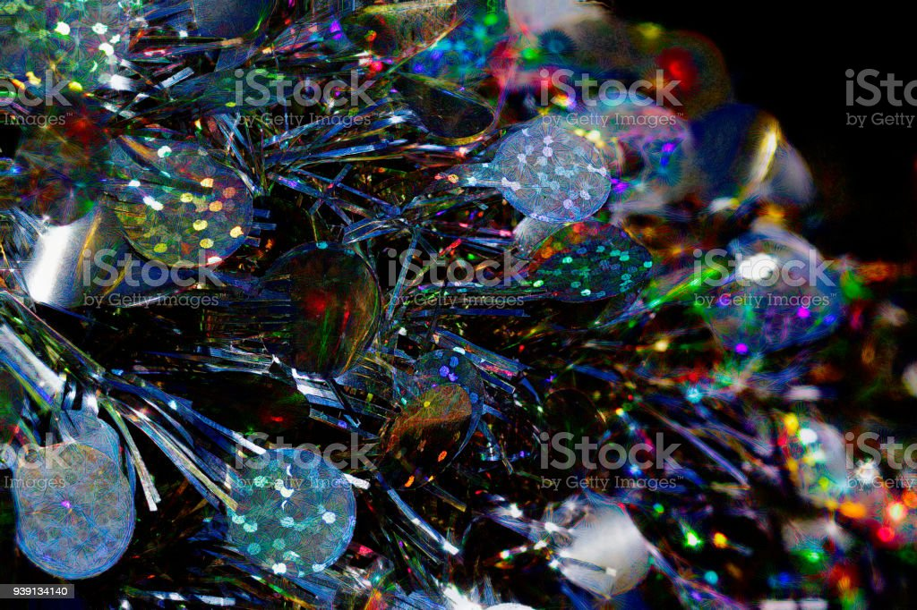 Flashing colours in silvery tinsel decorations background stock photo