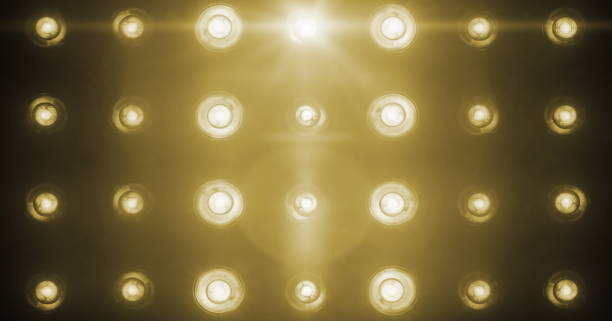 flashing shiny golden stage lights entertainment, spotlight projectors in the dark, gold warm soft light spotlight strike on black - stage light stock pictures, royalty-free photos & images