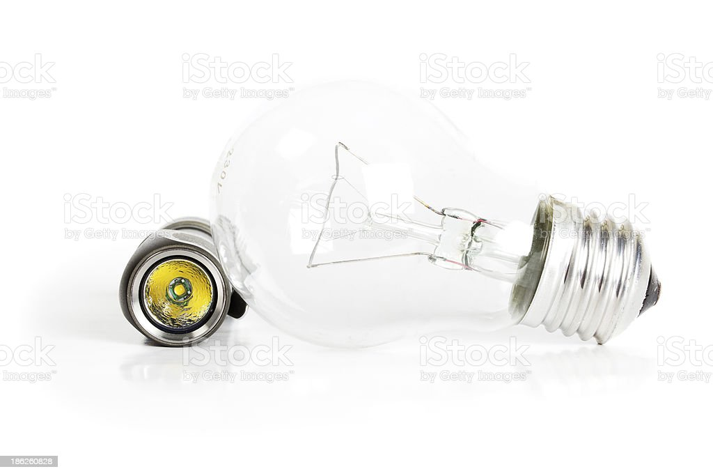 Flashlight and incandescent lamp royalty-free stock photo