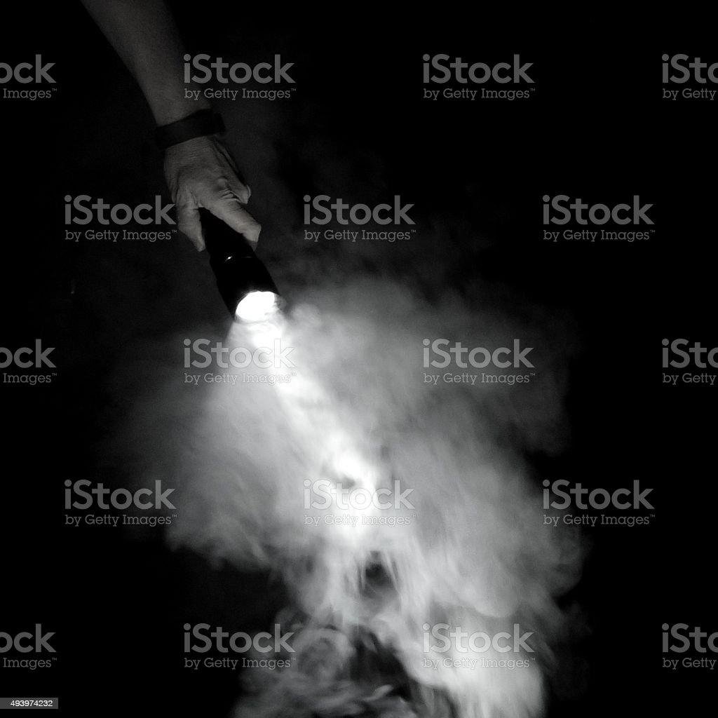 Flashlight and Smoke stock photo