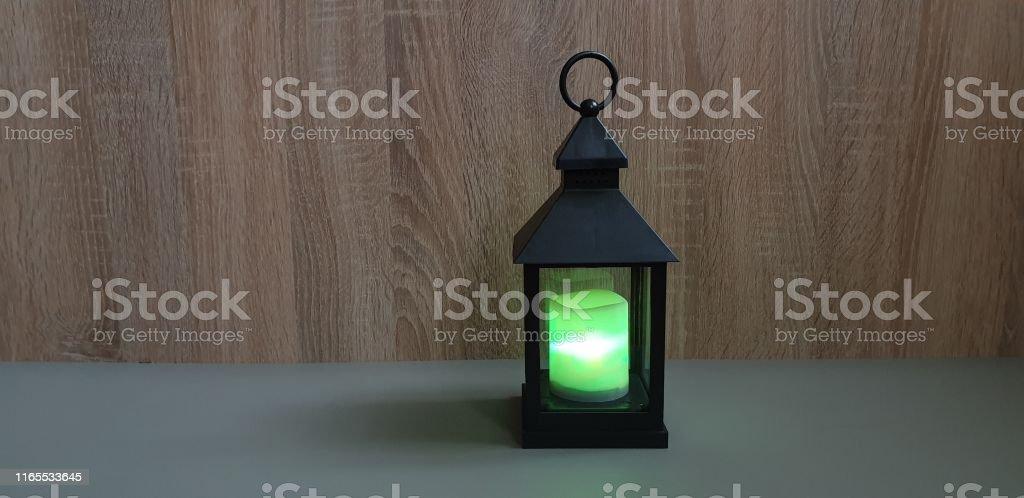Flashlight. Home lighting. Multi-colored lantern. Lantern candle. The...