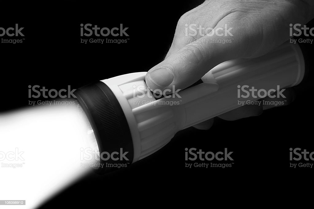 Flashlight on a black background royalty-free stock photo