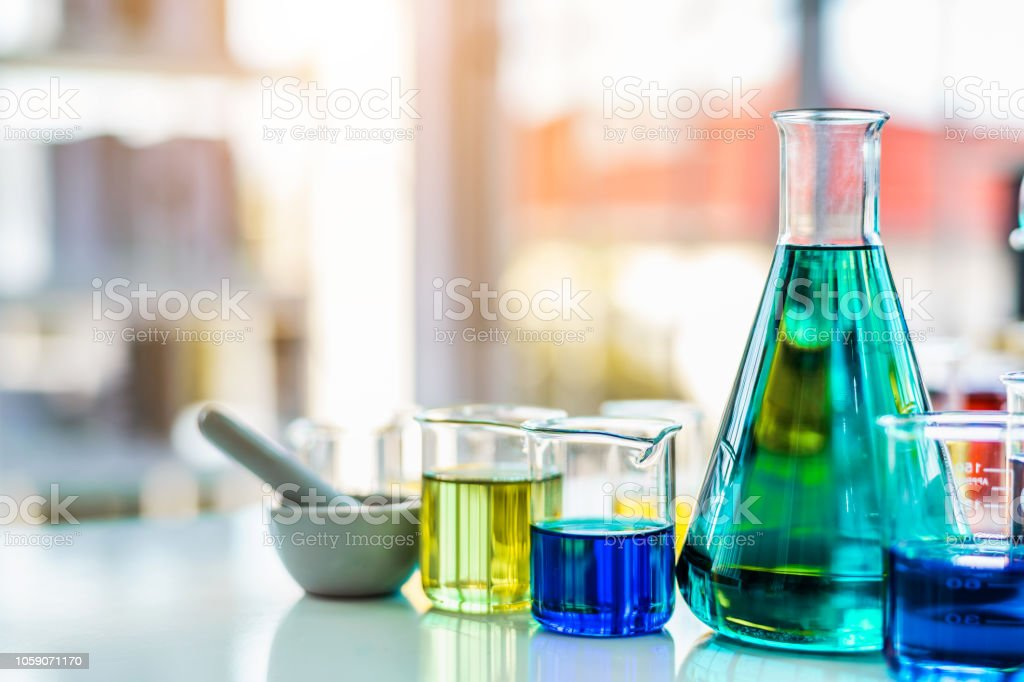 Flask containing chemical liquid in laboratory, lab chemical research...