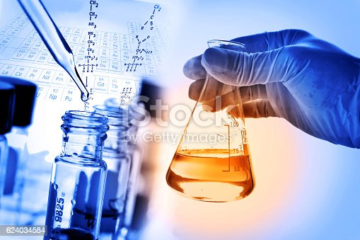 istock Flask in scientist hand with laboratory background 624034584