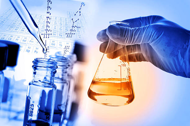 flask in scientist hand with laboratory background - laboratory equipment stock photos and pictures