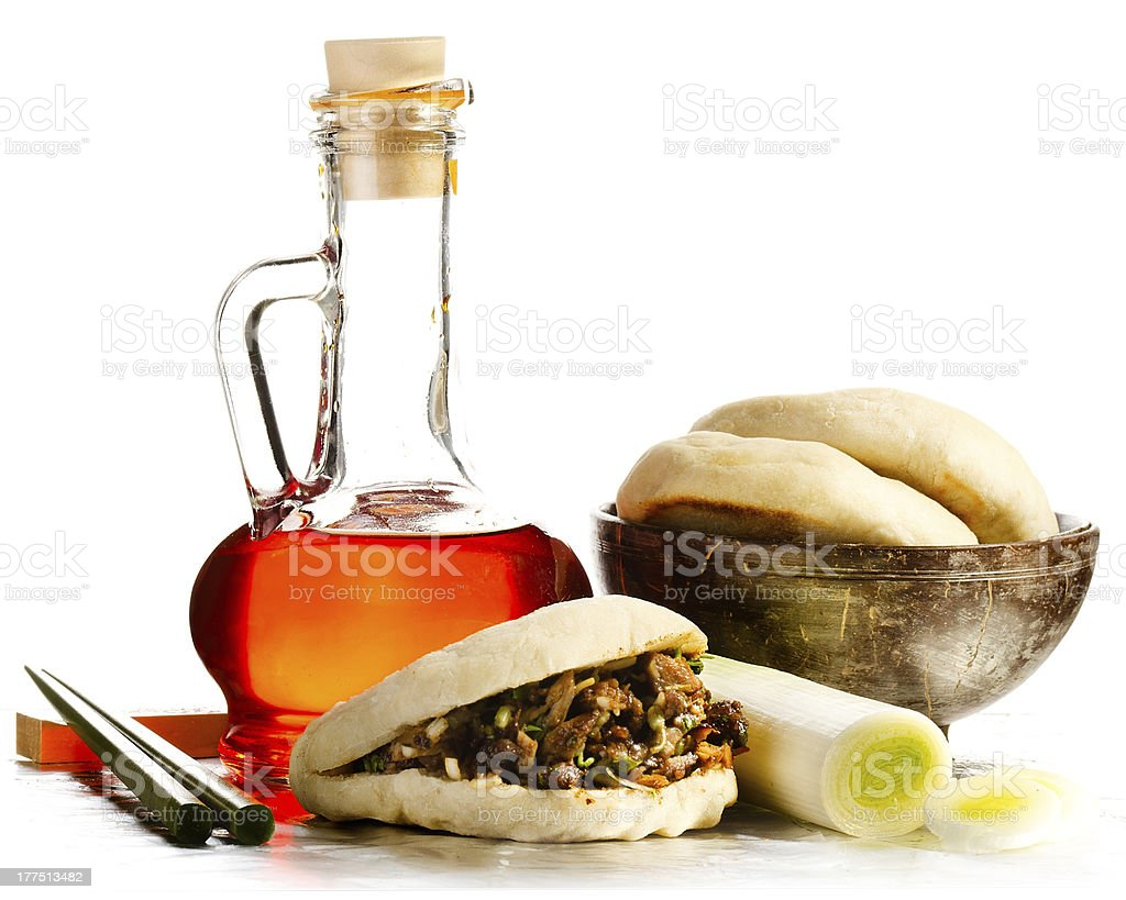 Flask of Chili oil with chinese hamburger and chopsticks royalty-free stock photo