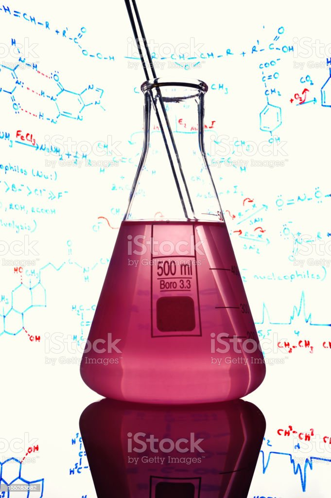 Flask surrounded by chemical formulas stock photo