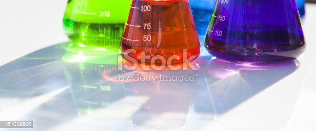 Multicolored Flasks on white background with shadow