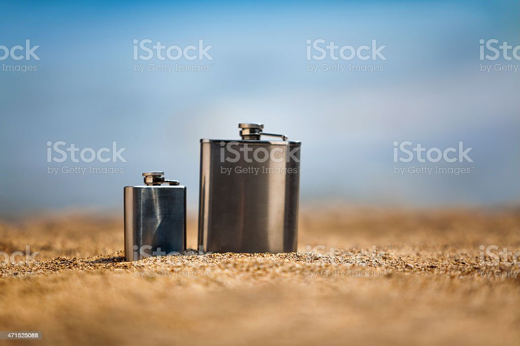 Flasks on beach stock photo