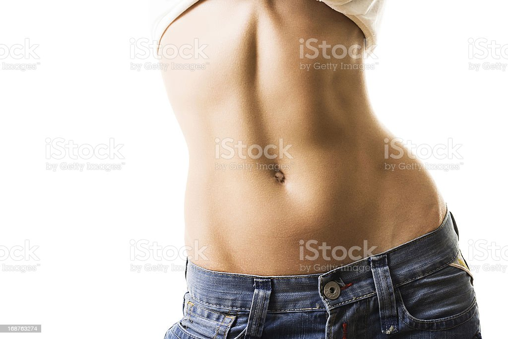 Flat and muscular female abdomen stock photo