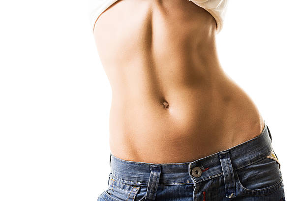 Flat and muscular female abdomen stock photo