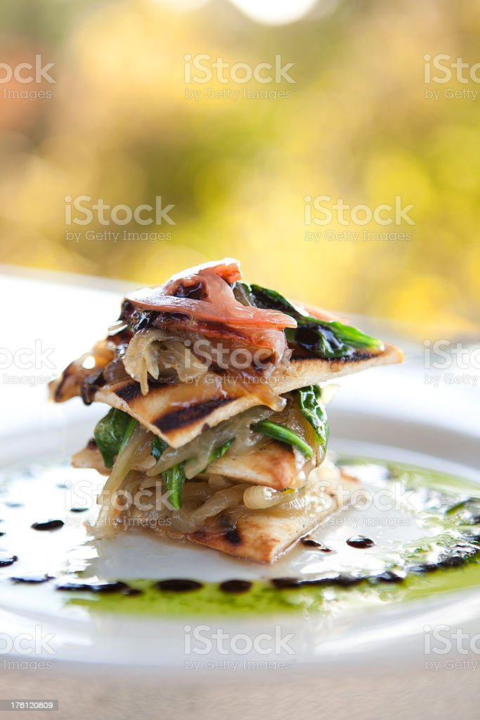 Flat bread Napolean Appetizer at a restaurant royalty-free stock photo