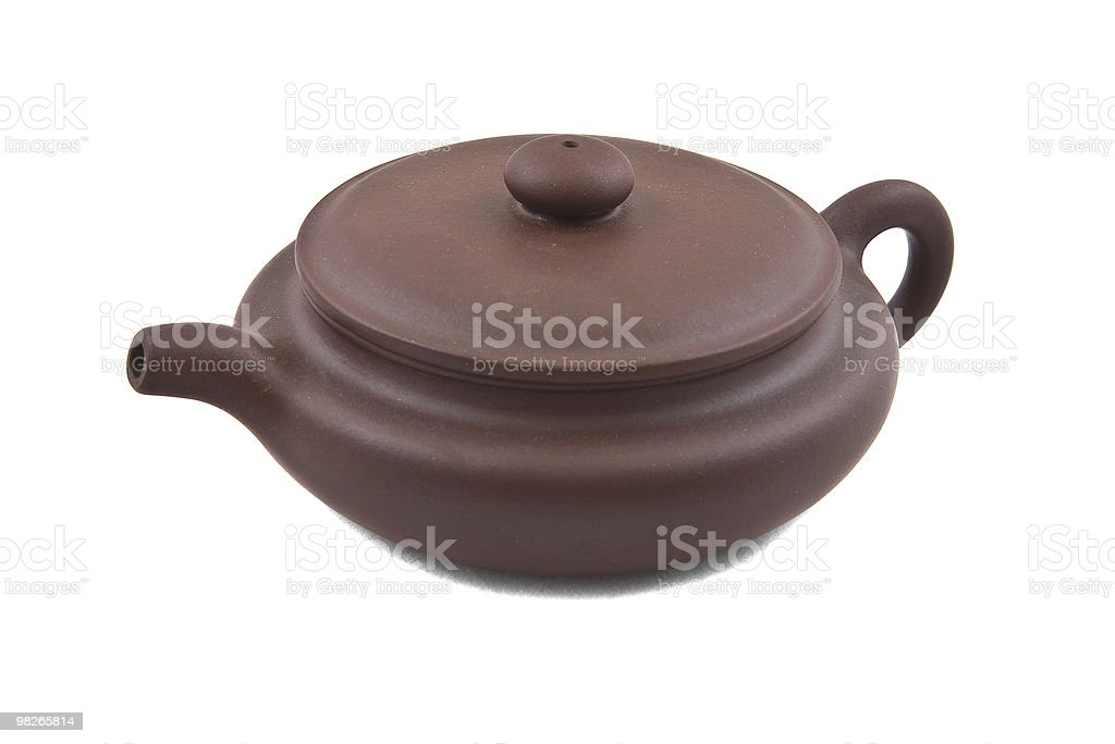flat brown ceramic teapot with cover royalty-free stock photo
