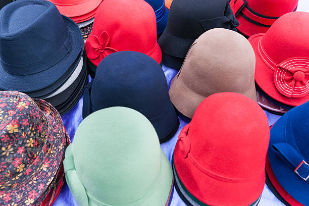 flat design selection of colored hats stacked in display. - pret a porter photos et images de collection