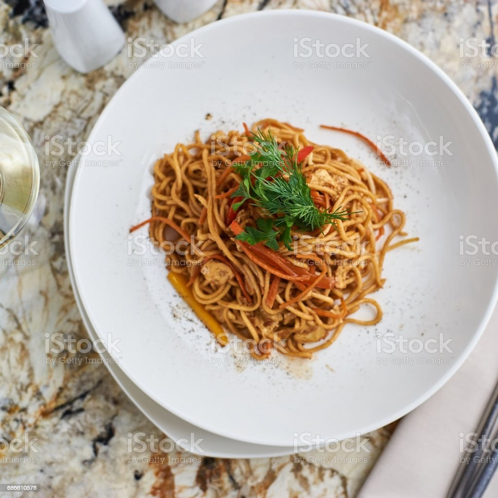 Flat egg noodles with vegetables royalty-free stock photo