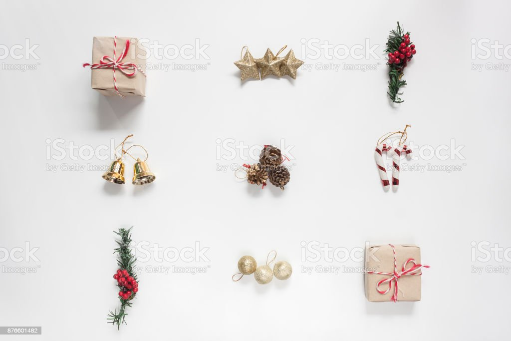 Flat lay aerial image of decoration & ornament Merry Christmas and Happy new year concept.Beautiful essential accessories on modern rustic white background at home office desk studio.Object for winter stock photo