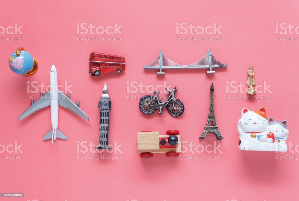 Flat lay aerial image of travel background concept.Table top view of souvenir symbol location or landmark of place for traveler all the world.objects on modern rustic pink paper.mock up & template. stock photo