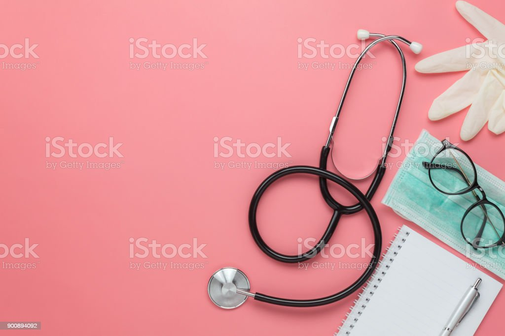 Flat lay aerial of accessories healthcare & medical background concept.Free space for mock up & template.Difference objects on modern rustic pink paper.An idea for essential tools doctor in hospital. stock photo