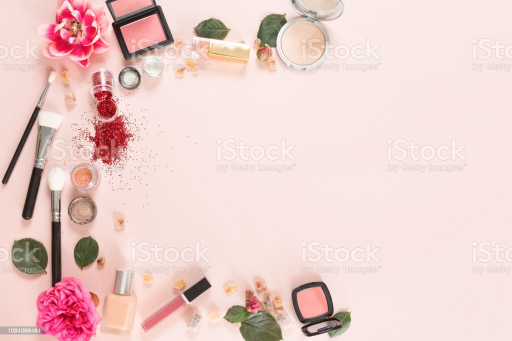 Flat lay and top view of make up products on white pink background...