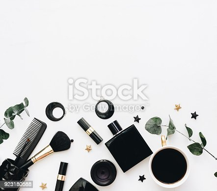 istock Flat Lay, Beauty blog concept. Female make up accessories on white background. top view of black trendy fashion feminine background. 923180588