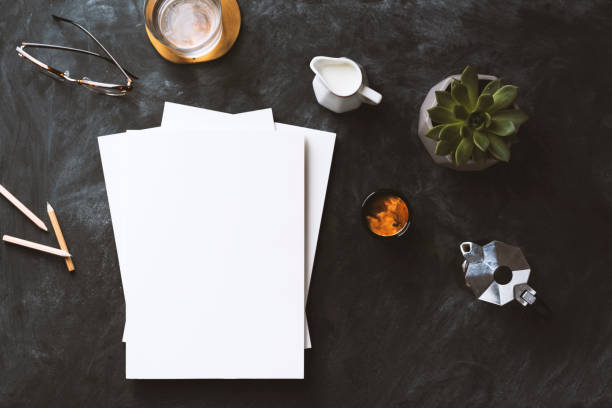 flat lay blackboard desktop with white blank magazine - magazine cover stock photos and pictures