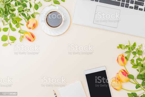 Flat lay blogger or freelancer workspace with a laptop yellow tulips picture id1221238983?b=1&k=6&m=1221238983&s=612x612&h=3c69gro6wviqtmlcxhiheqwgynxbnuz6svylbmrnf0y=