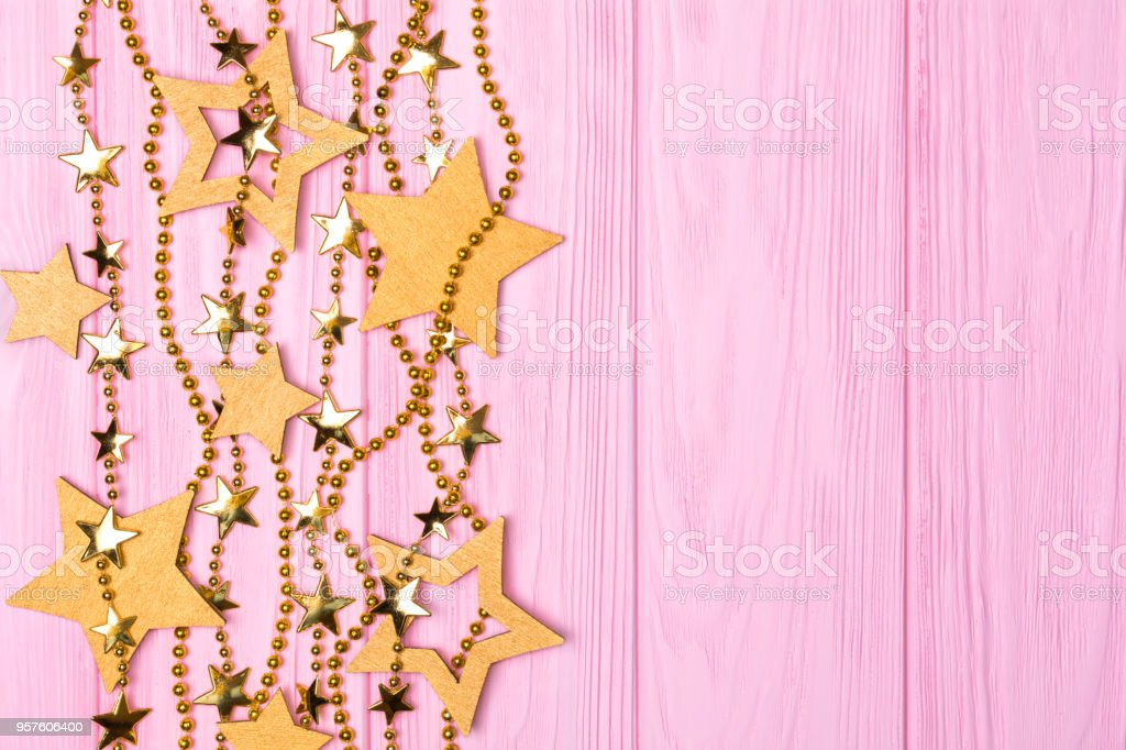 Flat Lay Border Of Big And Small Stars Confetti Golden Beads On Pink Royalty