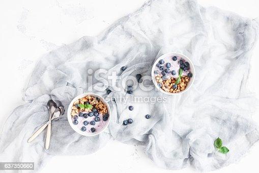 599887760 istock photo Flat lay breakfast with yogurt, muesli, berries 637350660
