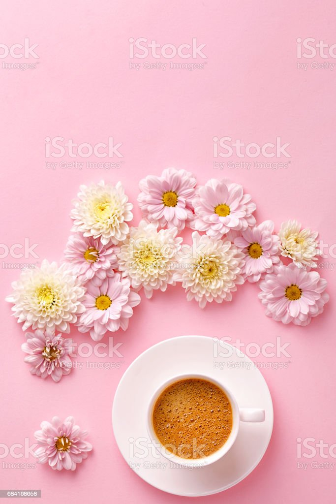 Flat lay coffee cup with flowers. Pink pastel background. Copy space. Top view. royalty-free stock photo
