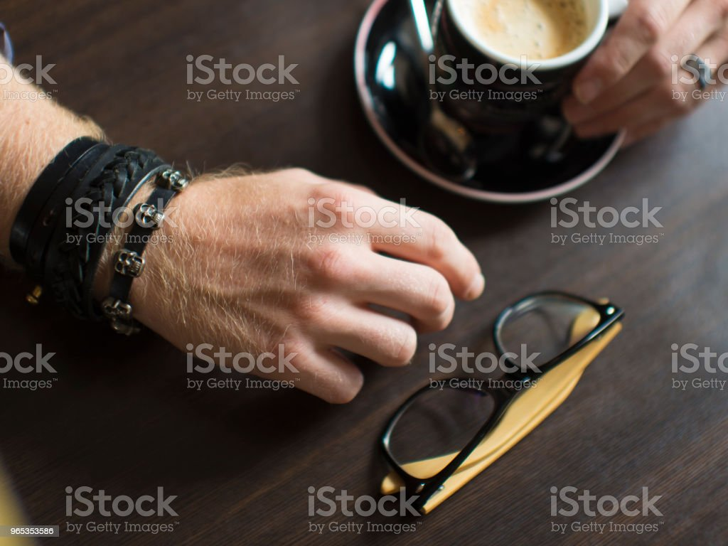 Flat lay Coffee with hand lift coffee cup , glasses, hand royalty-free stock photo