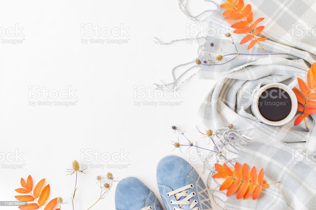 Flat lay composition with a sneakers, scarf, cup of coffee and...