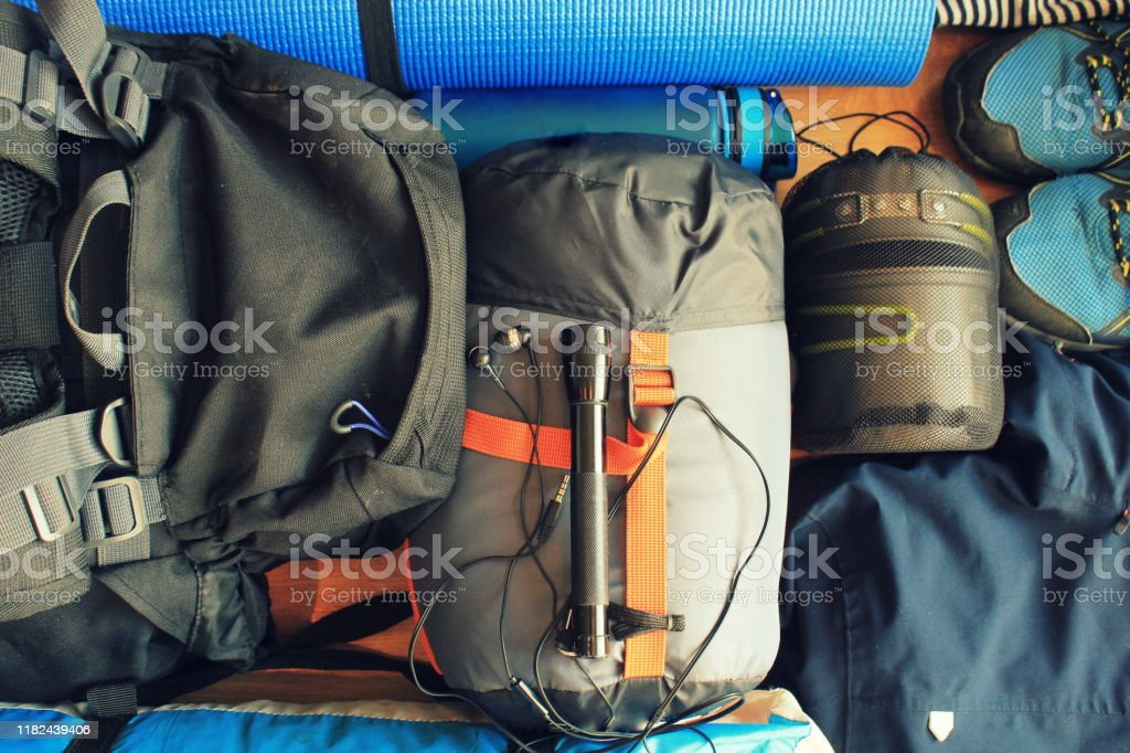 Flat lay composition with camping equipment on wooden background Flat lay composition with camping equipment on wooden background Adventure Stock Photo