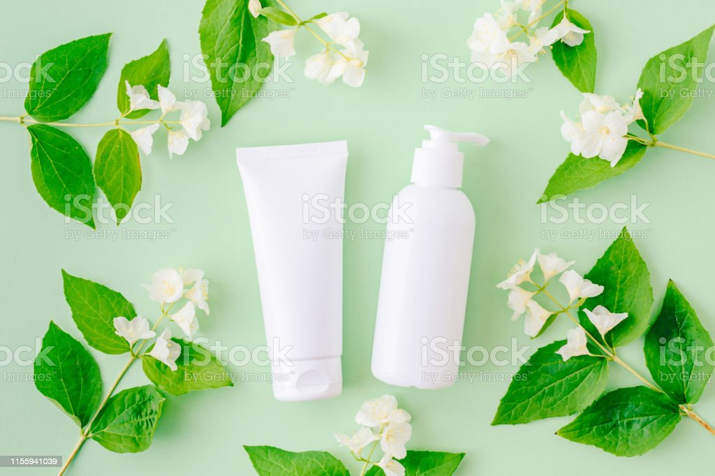 Flat lay composition with cosmetic products, mockup white tubes and...