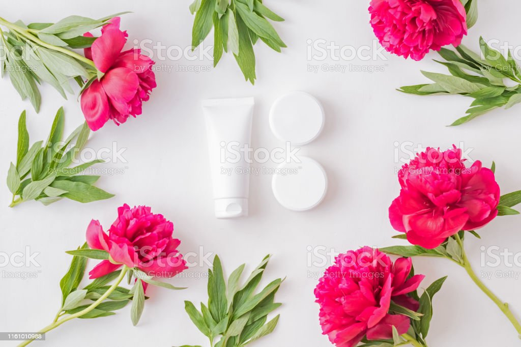 Flat lay composition with cosmetic products, mockup white tubes, jar...