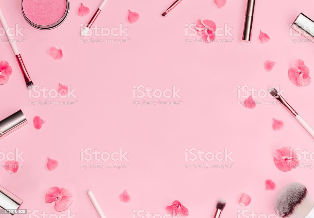 Flat lay composition with decorative makeup products and bright pink...