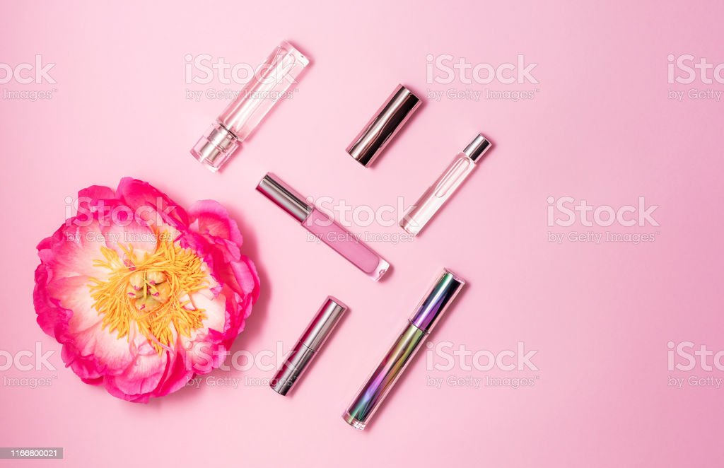 Flat lay composition with decorative makeup products, perfume and...