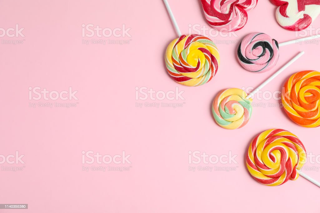 Flat lay composition with different candies and space for text on...