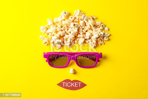 956942702 istock photo Flat lay composition with movie watching accessories on yellow background, top view 1167758530