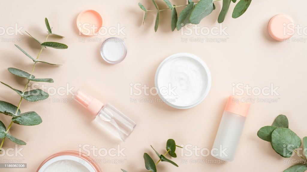 Flat lay composition with natural organic cosmetic products on beige...