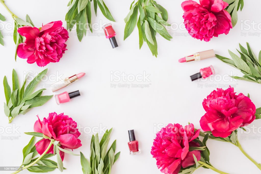 Flat lay composition with cosmetic products and red peonies on a...